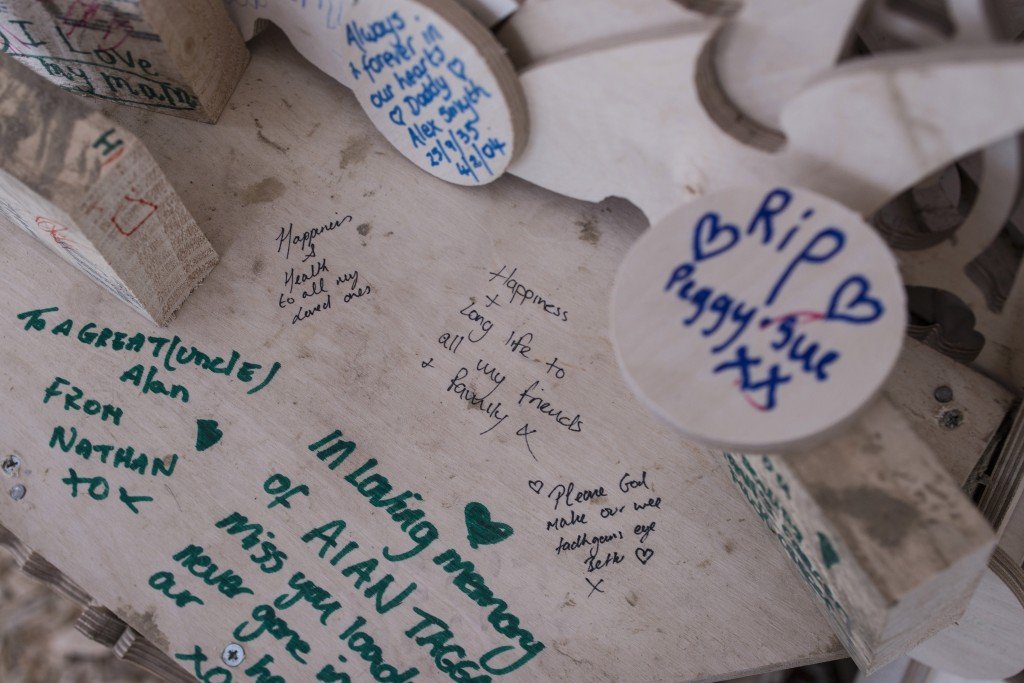 Messages remember loved ones and wish happiness and peace. Photo by Charles McQuillan/Getty Images