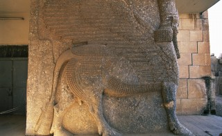 Photo of a lamassu (human-headed winged lion) in Palace of Ashurnasirpal II, 870 BC, Nimrud, Iraq. Photo by DeAgostini/Getty Images