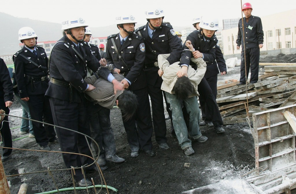 Trouble at Home Police subdue people who try to prevent law enforcement officers from demolishing an illegally built building on in Xian of Shaanxi Province, China, in 2006. Orders to demolish illegal structures mean eviction for residents, so Chinese law enforcement often has to forcefully remove residents, as well as protect the demolition sites from attack. (China Photos/Getty Images)
