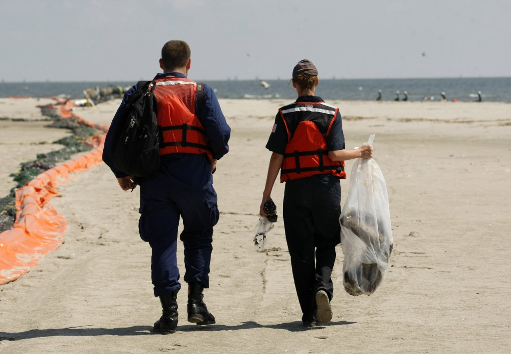 Dead Pelican Coast Guard personnel carry off the dead pelican, May 20, 2010. (AP Photo/Gerald Herbert)