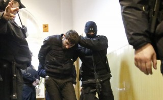 Zaur Dadayev is escorted in a court building in Moscow, March 8, 2015.A Russian human rights overseer reported that Dadayev claims to have been coerced into confessing to Nemtsov's murder. Photo by Maxim Shemetov/Reuters