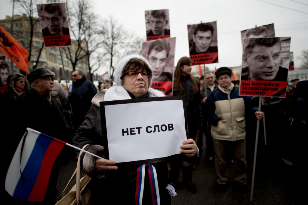 "A woman holds a poster reading ""No words"" during a march in memory of murdered Kremlin critic Boris Nemtsov in central Moscow on March 1, 2015. The 55-year-old former first deputy prime minister under Boris Yeltsin was shot in the back several times just before midnight on February 27 as he walked across a bridge a stone's throw from the Kremlin walls. AFP PHOTO / DMITRY SEREBRYAKOV        (Photo credit should read DMITRY SEREBRYAKOV/AFP/Getty Images)"
