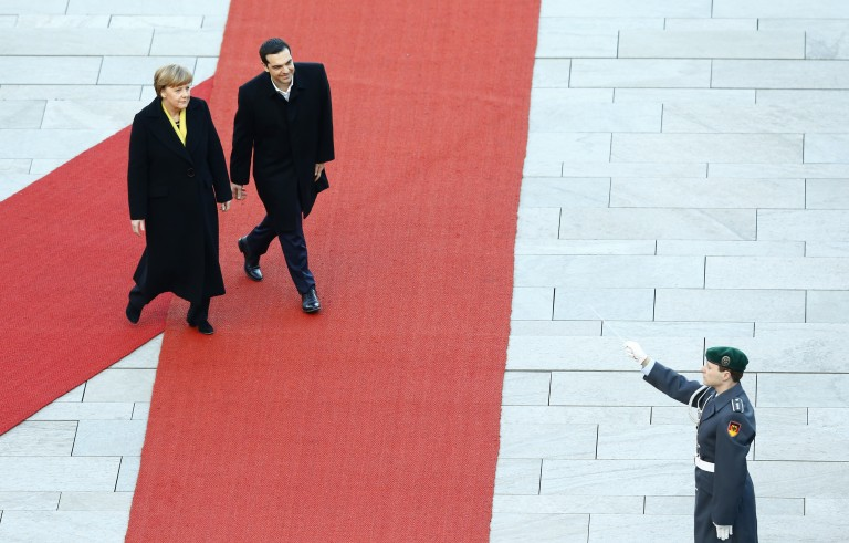 German Chancellor Angela Merkel and Greek Prime Minister Alexis Tsipras review an honour guard during a welcoming ceremony at the Chancellery in Berlin March 23. Tsipras met Merkel on Monday evening, his first official visit, to discuss Greece's bailout and reform. Photo by      REUTERS/Pawel Kopczynski.