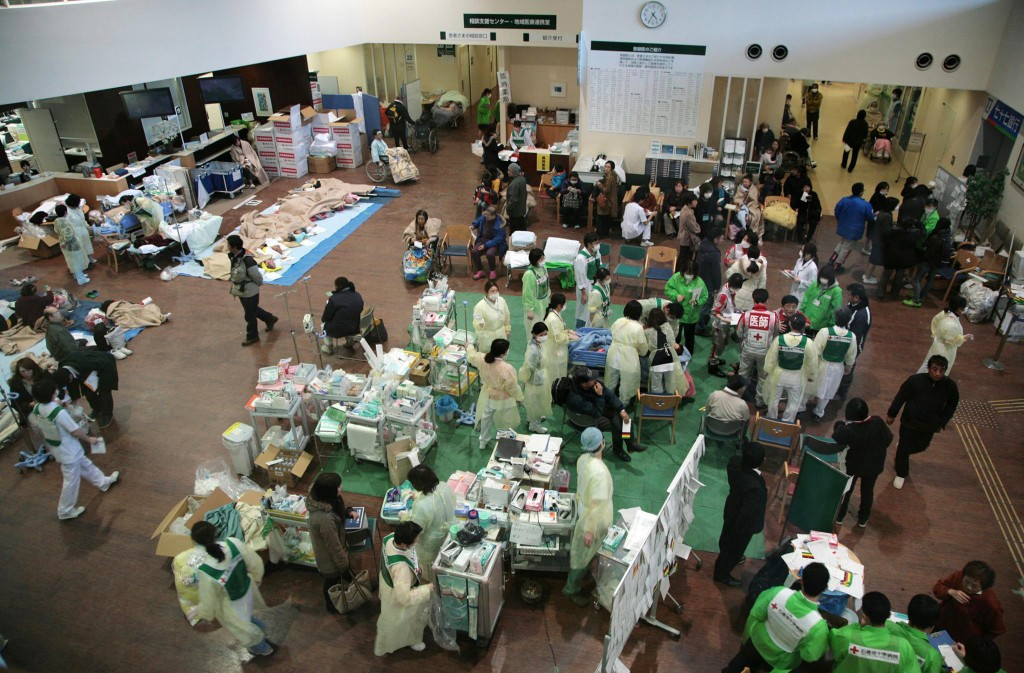 Survivors of an 9.0-magnitude earthquake and tsunami receive treatment at the Ishinomaki Red Cross hospital March 12, 2011. Photo by Toshirharu Kato/Japanese Red Cross/via Reuters