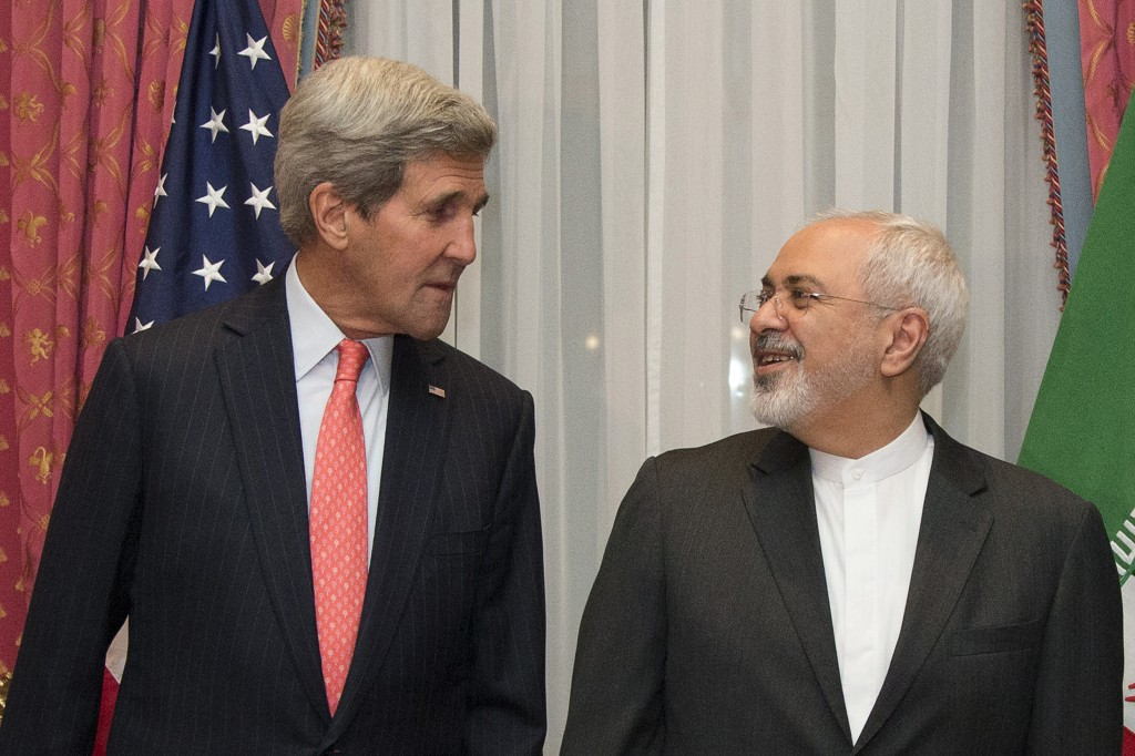 U.S. Secretary of State John Kerry, left, and Iran's Foreign Minister Mohammad Javad Zarif pose for a photograph before resuming talks over Iran's nuclear program in Lausanne, Switzerland. March 16, 2015. Photo by Brian Snyder/Reuters