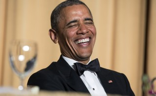 President Barack Obama laughs at a joke during the White House Correspondents' Association Dinner in Washington May 3, 2014. Obama and Wisconsin Gov. Scott Walker told jokes at the Gridiron Club and Foundation's annual dinner Saturday night. Photo by Joshua Roberts/Reuters