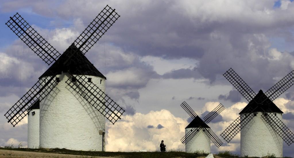 "Tourists visit the famous ancient windmills in the village of Campo de Criptana at the Castilla-La Mancha region in central Spain April 16, 2006. La Mancha windmills are part of the Miguel de Cervante's ""Don Quixote"", Spain's most famous literary character.  Photo by REUTERS/Victor Fraile"