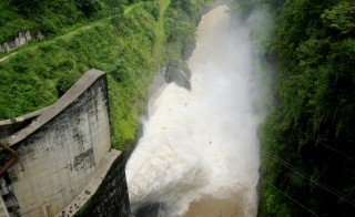 Water gushes out of a hydroelectric dam in  Costa Rica, May 25, 2007. Costa Rica has met all its energy needs using only renewables so far this year. Photo by Juan Carlos Ulate/Reuters.