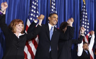 "U.S. President Barack Obama holds a rally celebrating the passage and signing into law of the Patient Protection and Affordable Care Act health insurance reform bill while at the Interior Department in Washington, March 23, 2010. (L-R) Connie Anderson, of Seville, Ohio, Obama, Vicki Kennedy, wife of former Sen. Edward Kennedy, and 11 year-old Marcelas Owens, of Seattle, Washington. ""When I sign this bill, all of the overheated rhetoric over reform will finally confront the reality of reform,"" the president said. Photo by Larry Downing/Reuters."