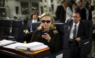 Former Secretary of State Hillary Clinton checks her PDA on a flight from Malta to Tripoli, Libya October 18, 2011.  Rep. Trey Gowdy said Friday that Clinton has permanently deleted all emails from her personal email server. Photo by Kevin Lamarque/Reuters