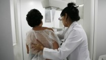 A woman undergoes a free mammogram inside Peru's first mobile unit for breast cancer detection, in Lima