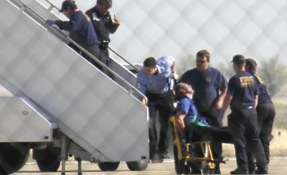 Former JetBlue pilot captain Clayton Osbon, is removed from the plane after erratic behavior forced the crew to land in Amarillo, Texas, March 27, 2012. Osbone is suing the airlines $16 million. Photo by Steve Miller/The Reporters Edge/REUTERS.