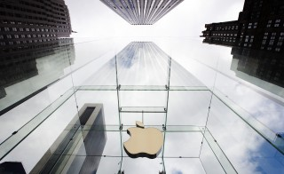 The Apple logo hangs in a glass enclosure above the 5th Ave Apple Store in New York, September 20, 2012.  Apple's iPhone 5 goes on sale tomorrow. Photo by Lucas Jackson/Reuters