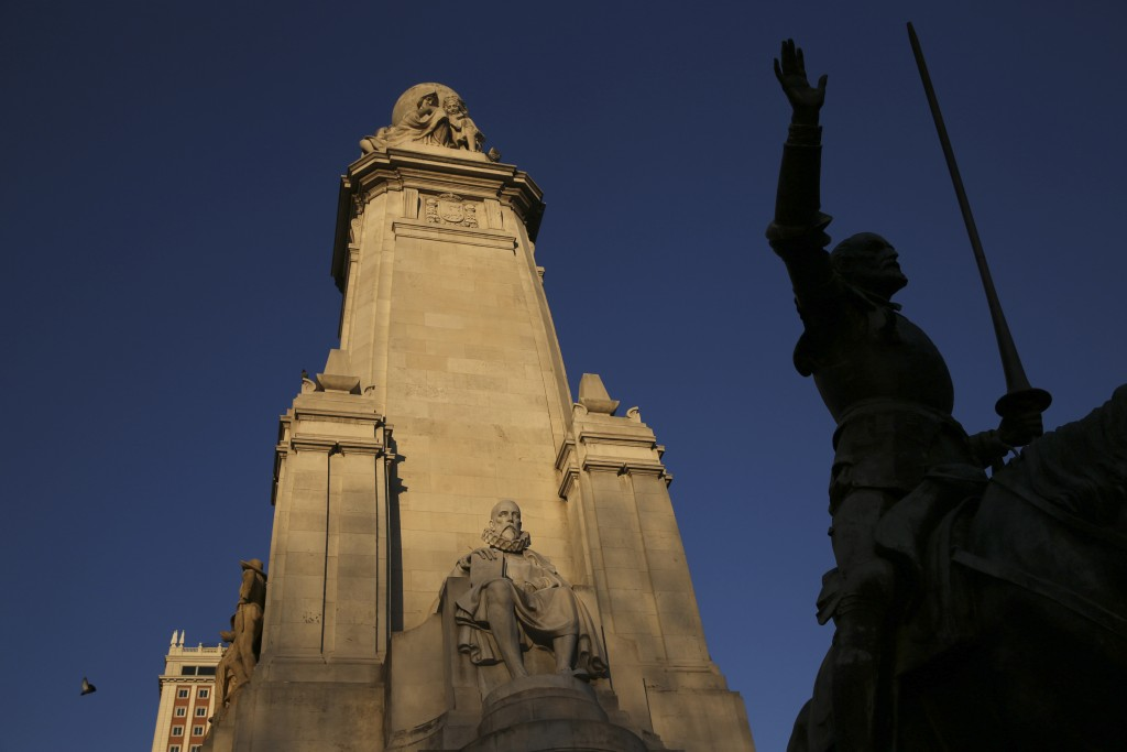 The statue of Miguel de Cervantes is seen next to the statue of one of his most famous characters, Don Quixote, from his famous novel at the monument in his honour at Plaza de Espana square in central Madrid March 7, 2014. Photo by REUTERS/Susana Vera