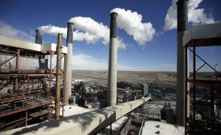 Steam rises from the stakes of the coal-fired Jim Bridger Power Plant supplied by the neighboring Jim Bridger mine that is owned by energy firm PacifiCorp and the Idaho Power Company, outside Point of the Rocks, Wyoming  March 14, 2014. West Virginia mined 120 million tons (109 metric tons) of coal in 2012, second to Wyoming, or about 12 percent of total U.S. production. Kentucky was third with about 9 percent of output, according to the National Mining Association. Photo by Jim Urquhart/Reuters In Wyoming, there has been heated debate about cutting down on the country's reliance on coal, an important resource in the state's economy.