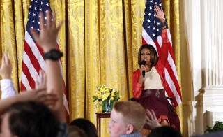 U.S. first lady Michelle Obama takes questions wile speaking with children of Executive Office employees at last year's annual Take Our Daughters and Sons to Work Day in Washington April 24, 2014. Obama urges expansion of efforts to include children. Kevin Lamarque/REUTERS