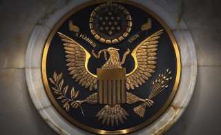 The Great Seal of the United States is pictured on a wall in courtroom 9C during a special session of the United States District Court for the Southern District of New York on the occasion of the 225th anniversary of the first session of the court in New York November 4, 2014.       REUTERS/Carlo Allegri (UNITED STATES - Tags: ANNIVERSARY CRIME LAW POLITICS SOCIETY) - RTR4CUA4