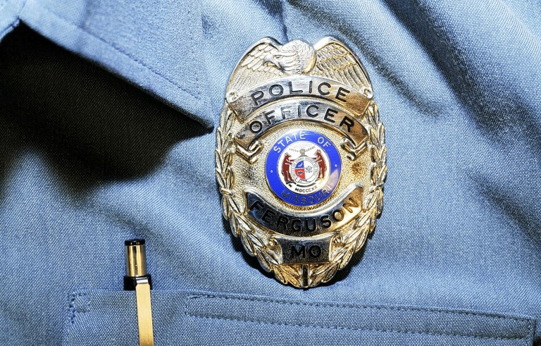Officer Darren Wilson's police badge is pictured in this handout evidence photo from the Aug. 9 Ferguson Police shooting of Michael Brown in Ferguson, released by the St. Louis County Prosecutor's Office on November 24, 2014. Photo by St. Louis County Prosecutor's Office/Handout via Reuters