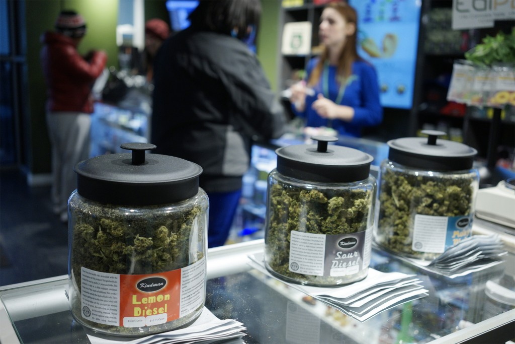 "Customers shop for ""Green Friday"" deals at the Grass Station marijuana shop on Black Friday in Denver, Colorado November 28, 2014. This is the first Black Friday since marijuana was legalized in Colorado January 1, 2014.  REUTERS/Rick Wilking (UNITED STATES - Tags: BUSINESS) - RTR4FZLA"
