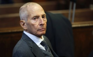 Real estate heir Robert Durst appears in a criminal courtroom for his trial on charges of trespassing on property owned by his estranged family, in New York  December 10, 2014 Durst, who was questioned about but never charged with several mysterious deaths and disappearances, is accused of violating the terms of a restraining order to keep away from relatives, including his brother, Durst Organization President Douglas Durst, in June 2013.  REUTERS/Mike Segar   (UNITED STATES - Tags: REAL ESTATE BUSINESS CRIME LAW SOCIETY) - RTR4HI32