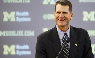Dec 30, 2014; Ann Arbor, MI, USA; Jim Harbaugh speaks to the media as he is introduced as the new head football coach of the Michigan Wolverines at Jonge Center. Photo by Rick Osentoski/USA TODAY Sports/via Reuters