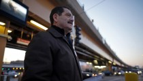 "Chicago Mayoral candidate Jesus ""Chuy"" Garcia waits to greet commuters outside a train stop in Chicago"