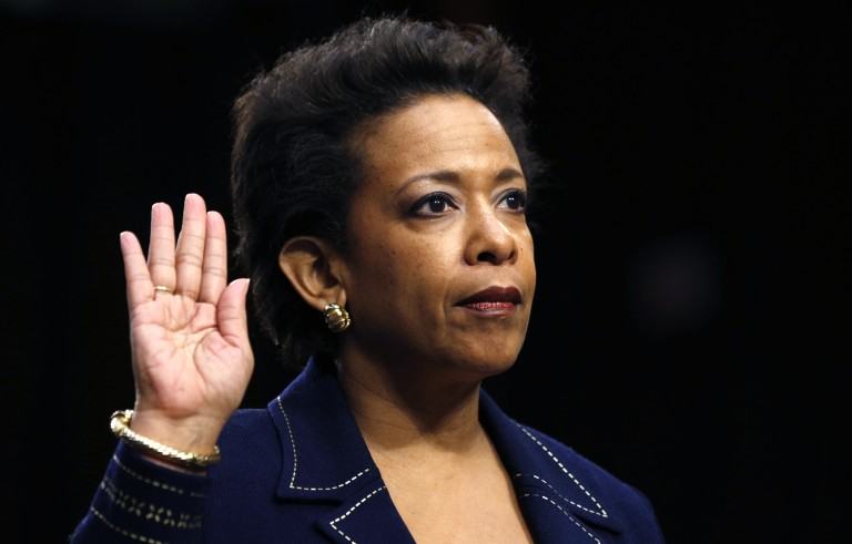 Loretta Lynch is sworn in to testify before a Senate Judiciary Committee confirmation hearing on her nomination to be U.S. attorney general on Capitol Hill in Washington January 28, 2015. Lynch, nominated in November, has stirred little controversy in her 16 years with the U.S. Attorney's office in Brooklyn and is expected to win confirmation. REUTERS/Kevin Lamarque  (UNITED STATES - Tags: POLITICS CRIME LAW TPX IMAGES OF THE DAY) - RTR4NBOF