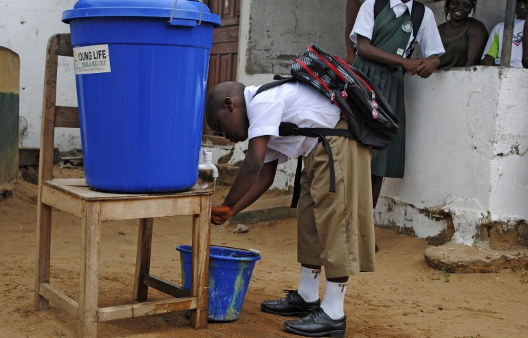 A boy washes his hands before going to school in Monrovia, Liberia, February 16, 2015. On Sunday, Liberian officials urged Ebola survivors to abstain from sex. Photo by James Giahyue/Reuters.