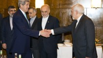 U.S. Secretary of State John Kerry shakes hands with Iran's Foreign Minister Mohammad Jawad Zarif (R) as they arrive to resume nuclear negotiations in Montreux March 2, 2015. US and European diplomats are united in nuclear negotiations with Iran. Photo by Evan Vucci/Pool/REUTERS.