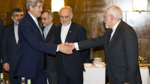 U.S. Secretary of State John Kerry shakes hands with Iran's Foreign Minister Mohammad Jawad Zarif as they arrive to resume nuclear negotiations in Montreux