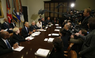 U.S. President Barack Obama meets with members of his Task Force on 21st Century Policing at the White House in Washington March 2, 2015. Photo by Kevin Lamarque/Reuters