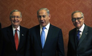 Israel's Prime Minister Benjamin Netanyahu meets U.S. Senate Majority Leader Mitch McConnell (R-KY) (L) and Senate Minority Leader Harry Reid (D-NV) (R) on Capitol Hill in Washington March 3, 2015. Netanyahu made an argument that many Israelis support in warning Congress on Tuesday about a potential nuclear deal with Iran, but critics asked whether it was worth the widening rift with the White House. Photo by Gary Cameron/Reuters
