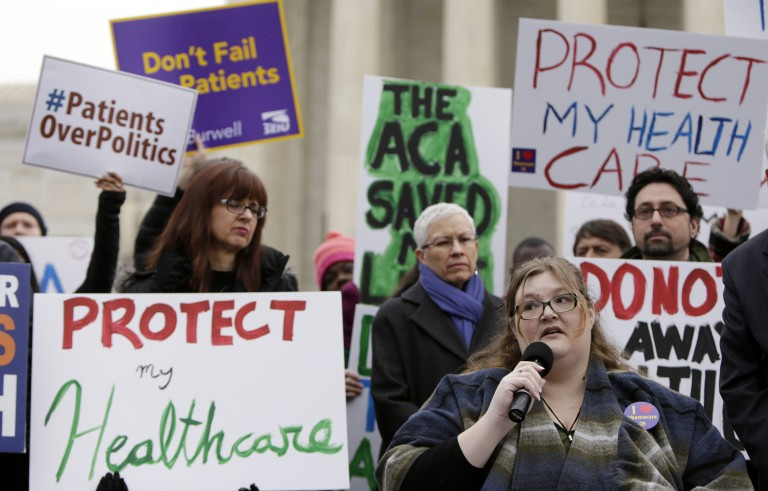Laura Hayes (with microphone), of Fort Wayne, Indiana tells fellow protestors how the Affordable Care Act helped her with health costs, during a protest in front of the Supreme Court in Washington March 4, 2015. The U.S. Supreme Court has been weighing a second major case, King vs. Burwell, targeting President Barack Obama's healthcare law. The case considers a conservative challenge to tax subsidies critical to the measure's implementation. Photo by Gary Cameron/Reuters