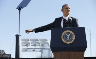U.S. President Barack Obama delivers remarks at the Edmund Pettus Bridge in Selma, Alabama, March 7, 2015. The remarks come on the 50th anniversary of the 'Bloody Sunday' march at the bridge, where police and state troopers beat and used tear gas against peaceful marchers who were advocating against racial discrimination at the voting booth.  REUTERS/Jonathan Ernst    (UNITED STATES - Tags: POLITICS ANNIVERSARY SOCIETY) - RTR4SGFE