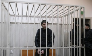 Zaur Dadayev looks out from a defendants' cage inside a court building in Moscow, March 8, 2015. Dadayev and four other men have been arrested in connection to the murder of opposition leader Boris Nemtsov. Photo by Tatyana Makeyeva/Reuters