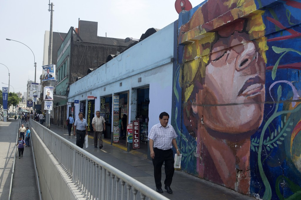 A man walks past a mural in Paseo De La Republica street in downtown Lima, Mar. 12, 2015. Credit: Mariana Bazo/REUTERS