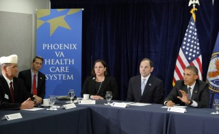 Disabled American Veterans Commander Ronald Cox (L), Iraq and Afghanistan Veterans of America leader Cara Campbell (3rd L), U.S. Veterans Affairs Secretary Robert McDonald (2nd R) and U.S. President Barack Obama (R) wrap up a meeting at the Phoenix VA Medical Center in Phoenix, Arizona March 13, 2015. Obama announced the formation of a new advisory group made up of public officials and leaders from the private sector to advise on improvements to the U.S. Department of Veterans Affairs during an event at the Phoenix VA facility, where long waits for medical care sparked a political crisis for the administration. Photo by REUTERS/Jonathan Ernst