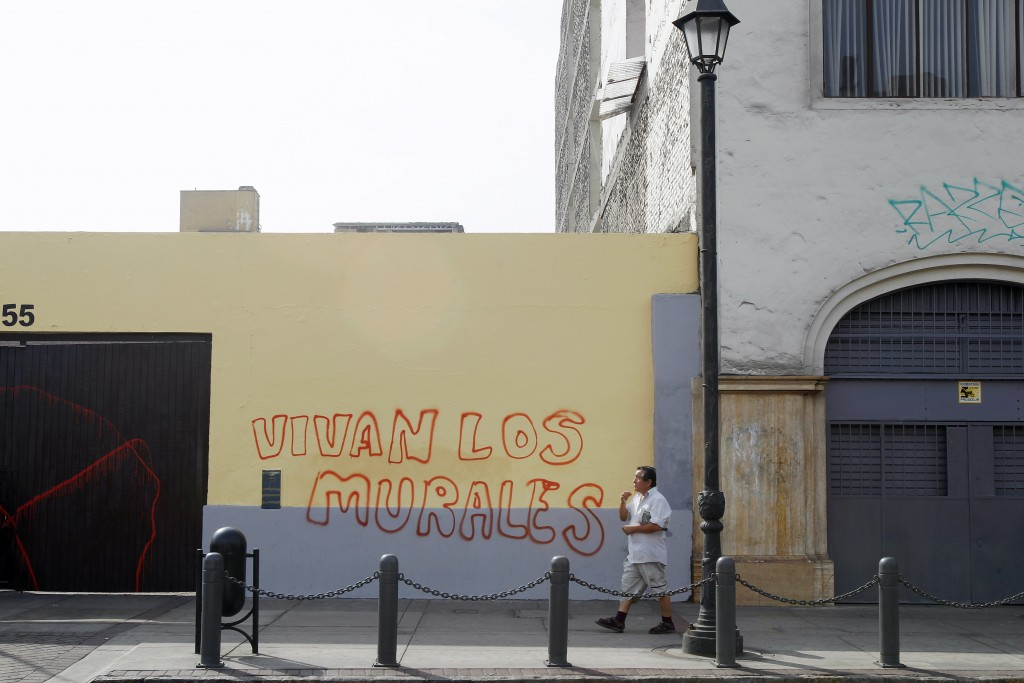 "Following the erasure of tens of murals in downtown Lima, the words on the wall read, ""Long live the murals"". Credit: REUTERS/Enrique"