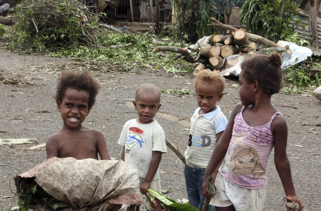 Children stand in front of debris on a street near their homes on March 15, 2015, after Cyclone Pam hit Port Vila, the capital city of the Pacific island nation of Vanuatu. Photo by Kris Paras/Reuters