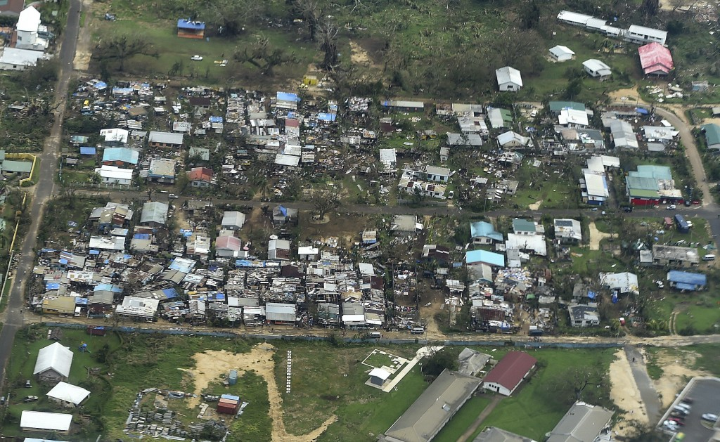 An aerial view on March 16, 2015, shows homes destroyed by Cyclone Pam in Port Vila, the capital of the Pacific island nation of Vanuatu. Photo by Dave Hunt/Pool/Reuters