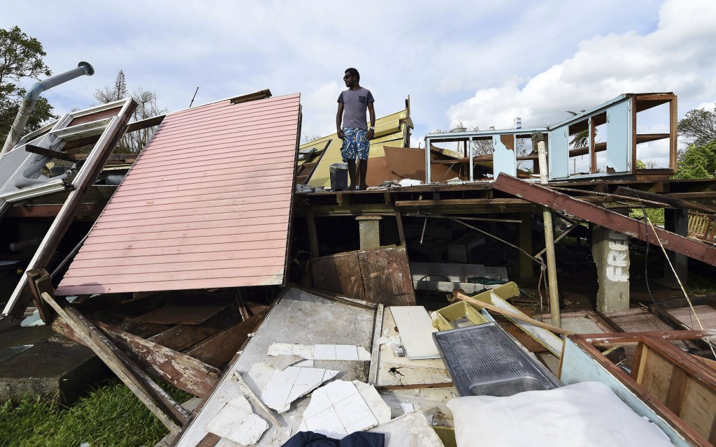 Local resident Adrian Banga stands in the remains of his home destroyed by Cyclone Pam in Port Vila, Vanuatu, in the South Pacific Ocean on March 16, 2015. Photo by Dave Hunt/Pool/Reuters