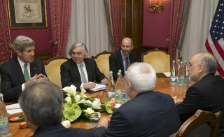 U.S. Secretary of State John Kerry (L) holds a meeting with Iran's Foreign Minister Javad Zarif (front C) over Iran's nuclear program in Lausanne on March 17, 2015.  Also at the negotiating table are U.S. Secretary of Energy Ernest Moniz (2nd L) and the head of the Atomic Energy Organization of Iran Ali Akbar Salehi (R). Photo by Brian Snyder/Reuters