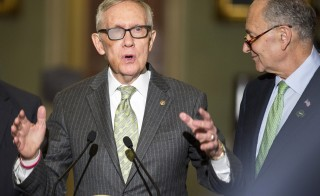 Senate Minority Leader Harry Reid (D-NV) speaks during a press conference as Senator Charles Schumer (D-NY) listens on Capitol Hill in Washington on March 17, 2015.      Photo by REUTERS/Joshua Roberts
