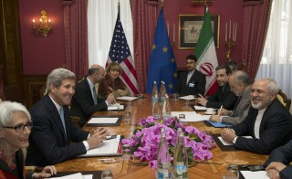 Secretary of State John Kerry (second from left) holds a negotiation meeting with Iran's Foreign Minister Mohammad Javad Zarif (right) over Iran's nuclear program in Lausanne, Switzerland, on Wednesday. Photo by Brian Snyder/Reuters