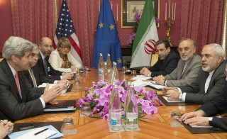 U.S. Secretary of State John Kerry (L) expresses his condolences over the death the of the mother of Iranian President Hassan Rouhani before a negotiation session with Iran's Foreign Minister Javad Zarif (R) over Iran's nuclear program in Lausanne on March 20, 2015. Both the U.S. and Iran have cited significant progress in the nuclear talks, but it is still unclear whether they will reach the March 31 deadline. Photo by Brian Snyder/Reuters