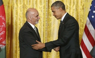 U.S. President Barack Obama shakes hands with Afghanistan's President Ashraf Ghani (L) after their joint news conference at the White House in Washington. Photo by REUTERS/Jonathan Ernst