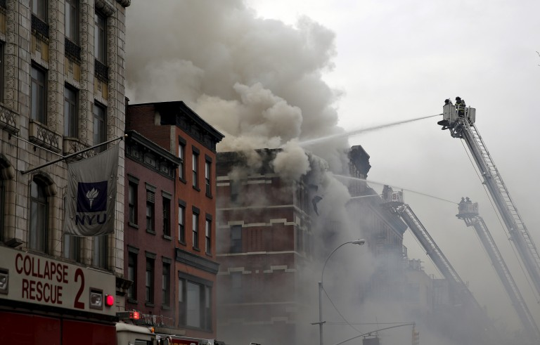 Firefighters battle fire at the site of a building collapse and fire in New York City's East Village neighborhood on March 26, 2015. Rescue workers pulled two bodies from the rubble Sunday afternoon. Photo by Mike Segar/Reuters