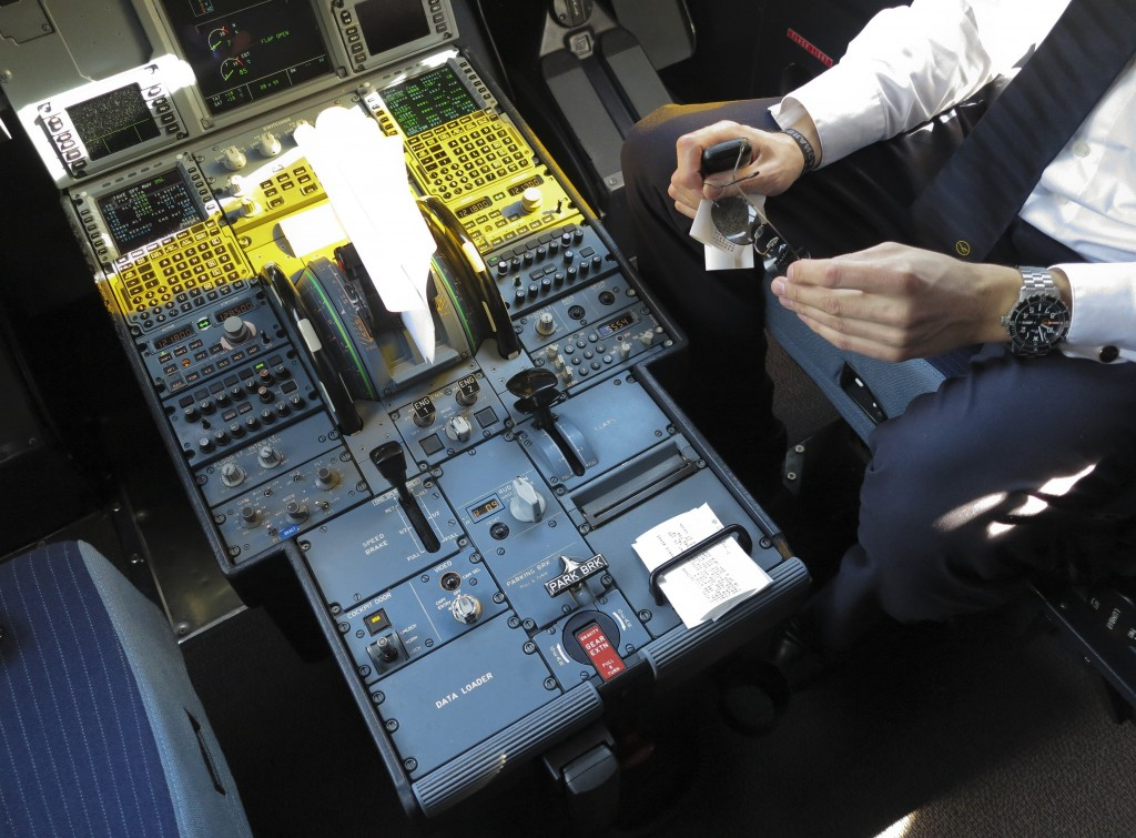 A pilot sits inside the cockpit of Airbus A321 during boarding for the Germanwings flight 4U9441, formerly flight 4U9525, from Barcelona to Dusseldorf March 27, 2015. The German pilot believed to have deliberately crashed a plane in the French Alps killing 150 people broke off his training six years ago due to depression and spent over a year in psychiatric treatment, a German newspaper reported on Friday. Photo by Albert Gea/Reuters