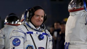 NASA astronaut Scott Kelly walks after donning space suit at the Baikonur cosmodrome