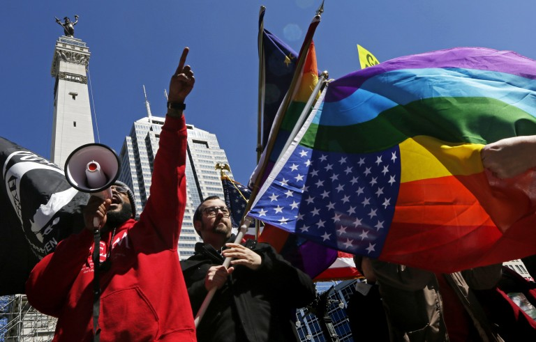 Demonstrators gather to protest a controversial religious freedom bill in Indianapolis